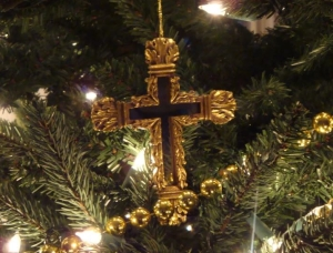 cross-christmas-ornament-on-tree